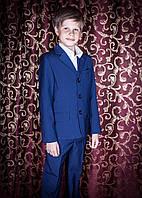 Школьный костюм-тройка для мальчика синего цвета