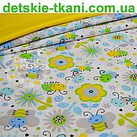 Ткань хлопковая с цветочным принтом жёлто-голубого цвета (№756).