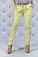 Женские брюки на шнурке желтые