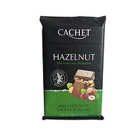 Молочный бельгийский шоколад Cachet Huzelnut Milk Chocolate- с целым лесным орехом