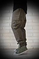 Брюки джоггеры с карманами карго зеленого цвета