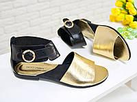 Босоножки золотого цвета из натуральной кожи  с черным задником