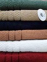 Однотонные махровые полотенца  ассортименте