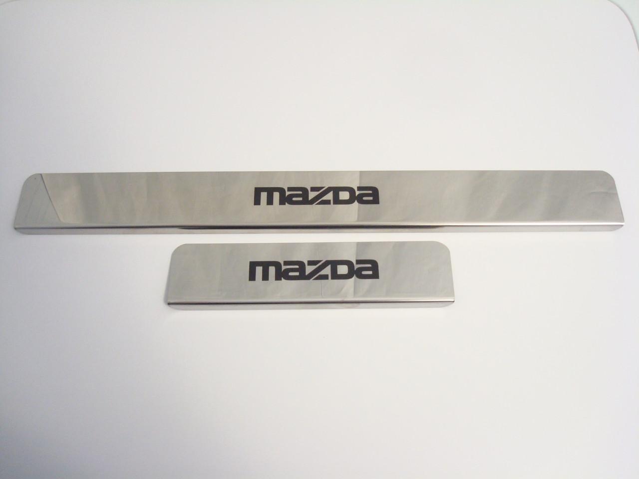 Хромированные накладки на пороги Mazda