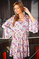 Платье на запах с завязками на плечах, рукав с воланом. Платье украшает красивый принт.