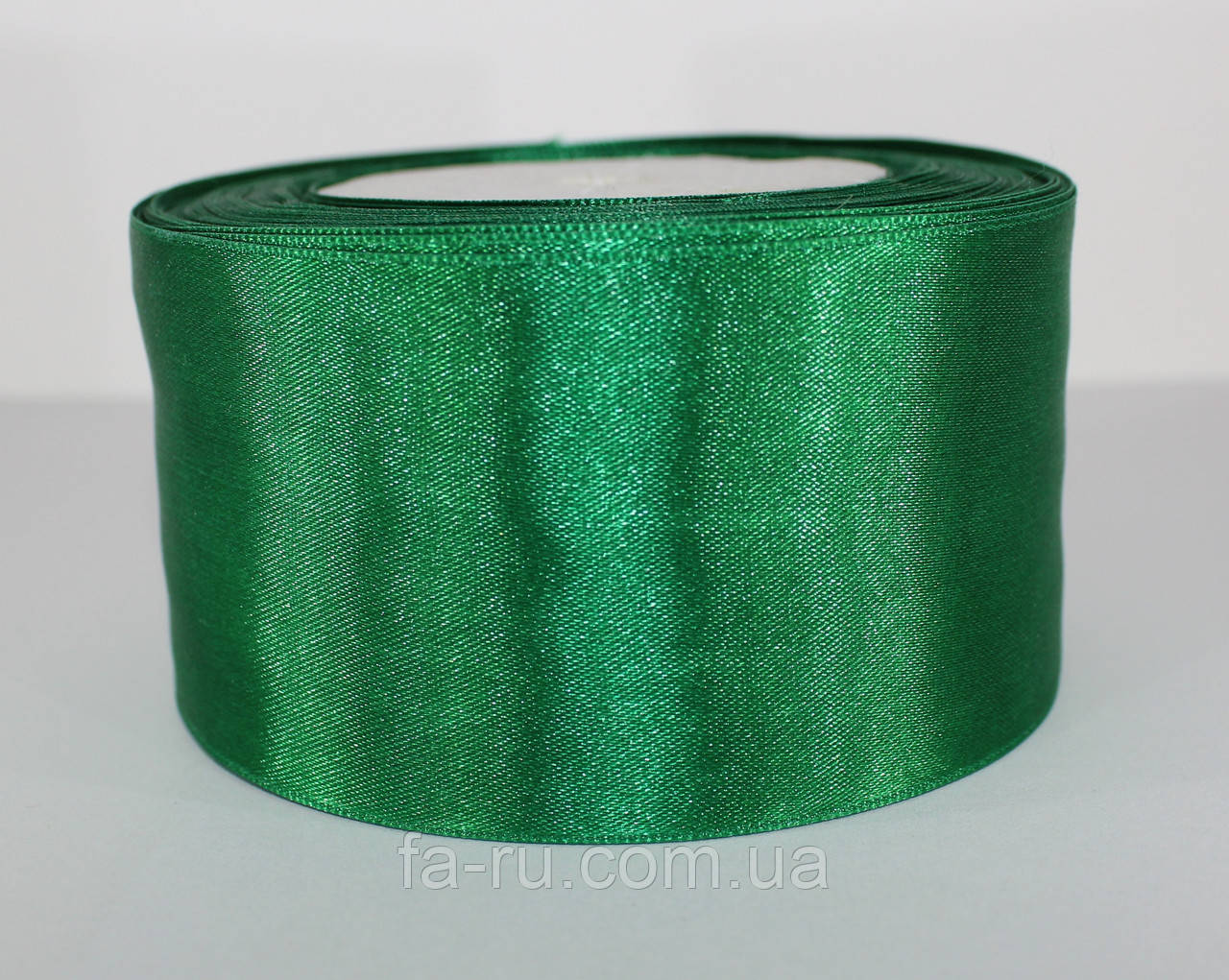 Лента атласная. Цвет - темно-зеленый. Ширина - 5 см, длина - 23 м