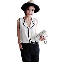 Блузка белая с черной окантовкой