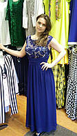 Вечернее платье синего цвета с прозрачной спинкой
