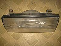 Фара основная левая Мазда Капелла Mazda Capella