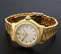 Часы золотые мужские.