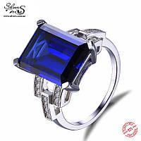 Серебряное кольцо с синим сапфиром и цирконием