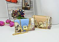 Женская стильная сумка на ручке-цепочке с шипами.