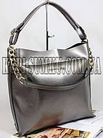 Стильная брендовая сумка цвета серебра