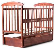 Детская кроватка «Наталка» откидная боковина, с маятником и ящиком (ясень) темная
