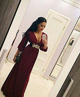 Однотонное длинное платье в пол с пышными рукавами и глубоким вырезом декольте