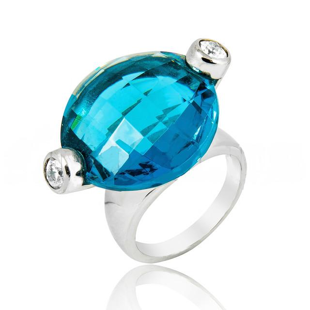 Серебряное кольцо с голубой шпинелью фото
