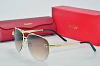 Солнцезащитные очки Cartier коричневый
