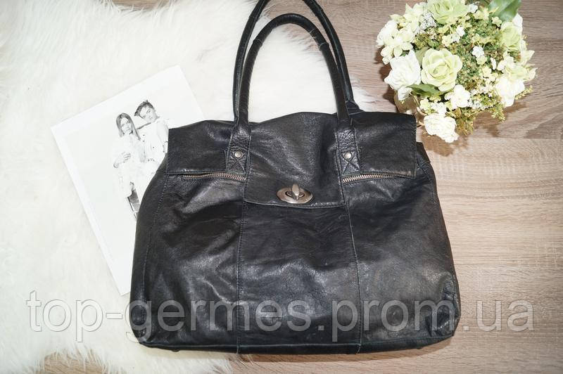 Кожанная сумка б.у,натуралная кожа 100%