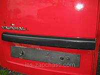 Накладка (молдинг) задней двери левая сторона с подсветкой номера Opel Combo