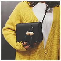 Женская сумка клатч с кисточкой