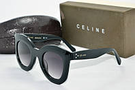 Солнцезащитные очки круглые Celine черные