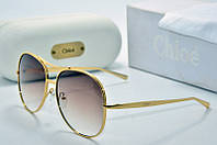 Солнцезащитные очки Chloe круглые в золотой оправе