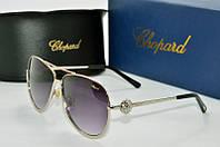Солнцезащитные очки Chopard темно-серые в серебряной оправе