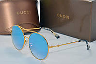 Солнцезащитные очки круглые Gucci голубые