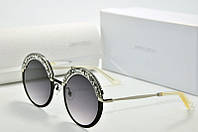 Солнцезащитные очки круглые Jimmy Choo черные