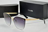 Солнцезащитные очки Prada черные