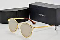 Солнцезащитные очки круглые Prada зеркальные