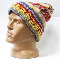 Шерстяная шапка вязаная с подворотом помпон