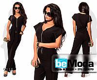 Необычный женский комбинезон на змейке с карманами по бокам черный