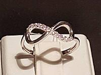 Серебряное кольцо Бесконечность с фианитами. Артикул 15025р