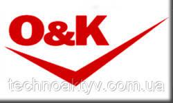 O&K (Компания Orenstein & Koppel) была основана в 1876 г. Бенно Оренштайном и Артуром Коппелем. Вскоре компания начала производство оборудования для железных дорог. В 1981 г. покинула сектор железнодорожного оборудования, сфокусировавшись на производстве строительной техники.  В начале нового столетия был создан первый многоковшовый экскаватор,  в 1908 г. - первый одноковшовый экскаватор, который передвигался по рельсам.  В 1922 г. изготовлен первый паровой одноковшовый экскаватор на гусеничном ходу.  В 1926 г. паровые двигатели были заменены на дизельные.  В 1934 году выпущен первый роторный экскаватор.  Компания также производила   грейдеры,  самосвалы,  краны,  колесные и гусеничные погрузчики, др.оборудование.  Продукция выпускалась на нескольких заводах в Германии.