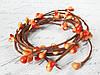 Декоративная веточка с тычинками оранжевого цвета