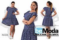 Милое женское платье больших размеров с воланами на рукавах и по краю низа синее с белым