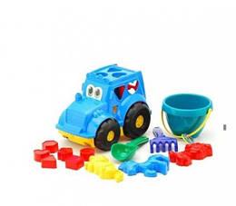 Дитячий набір:трактор з вкладишами, відро, лопата, граблі, 3 пасочки 0343