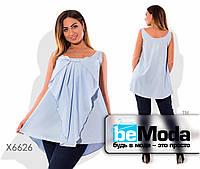 Необычная женская блуза свободного кроя с бантом впереди голубая