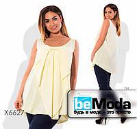 Необычная женская блуза свободного кроя с бантом впереди желтая