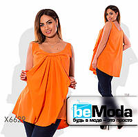 Необычная женская блуза свободного кроя с бантом впереди оранжевая