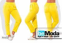 Оригинальные женские льняные брюки облагающего кроя на резинке желтые