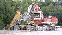 O & K экскаватор RH40-B в действии на месте добычи открытым способом Lhoist в Мендене, Германия