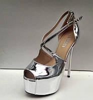 Женские туфли на высоком каблуке с открытым носом кожа лакированная серебряные Uk0442