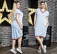 Асимметричной длины платье в спортивном стиле.