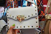 Модная женская сумка с оригинальным ремешком