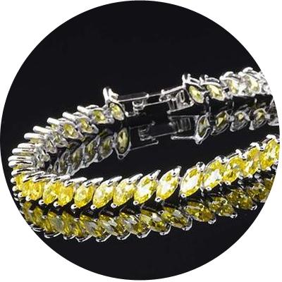 позолоченные и родированные браслеты с фианитами - бюджетный вариант драгоценному камню