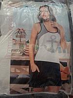 Женский молодежный костюм с шортами.