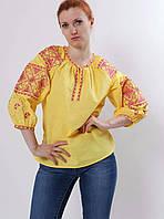 Желтая вышитая блуза с геометрическим узором