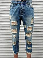 Женские джинсовые бриджи рванка